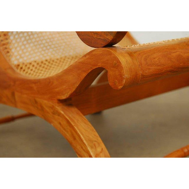 Hand-carved British Colonial plantation chair or planter's chair made of Anglo-Indian radiant grain teak and cane. Also...