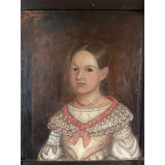Antique Circa 1820s American Itinerant Folk Art Oil on Canvas Portrait of a Girl in Period Folk Art Frame. Very nice...