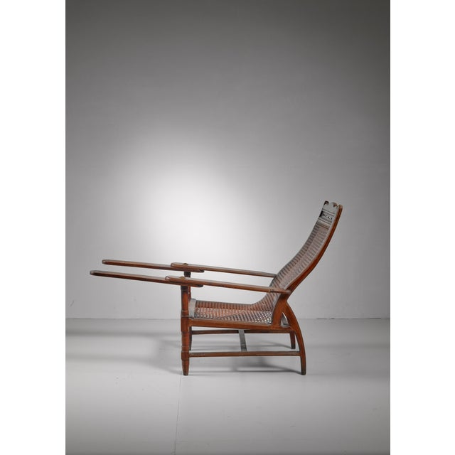 Planter's chair in teak, cane and brass, Italy, circa 1900 For Sale - Image 6 of 8