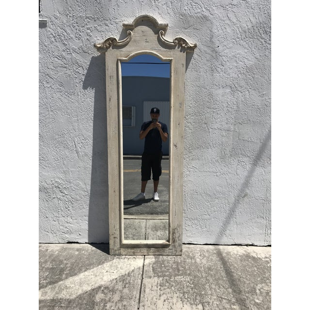 A tall wooden hall mirror crafted in a woodworking / cabinet shop outside of Barcelona, Spain....this mirror will make a...