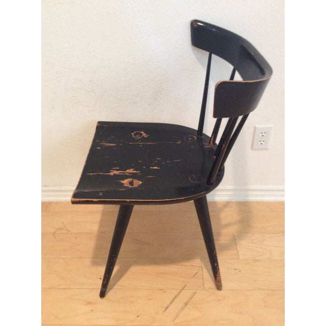 This Paul Mccobb Planner Group Chair is in true vintage condition with area of Maple base showing through the black...