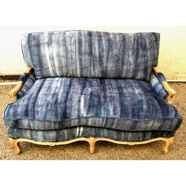 Antique French Settee stripped to show natural wood and recovered with Indigo dip dyed linen chenille fabric.