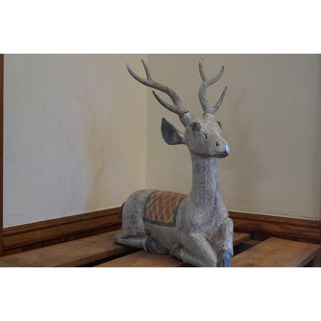 Exquisite large hand carved and hand painted deer sculpture which was created in India. This heavy weight beauty rests in...