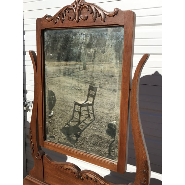 This washstand is dated October 8, 1903. The mirror attached to it was made by the same company who made the mirrors on...