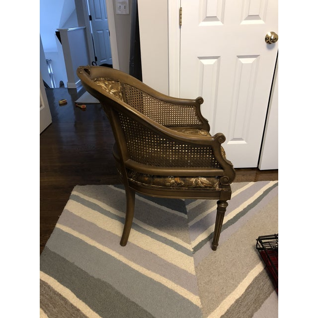 This chair is elegantly detailed from the 1940's and has been reupholstered with a peacock patterned fabric.