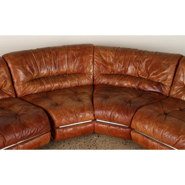An Italian mid-century modern chrome and leather five-piece sectional sofa circa 1970. Measurements of each piece below:...