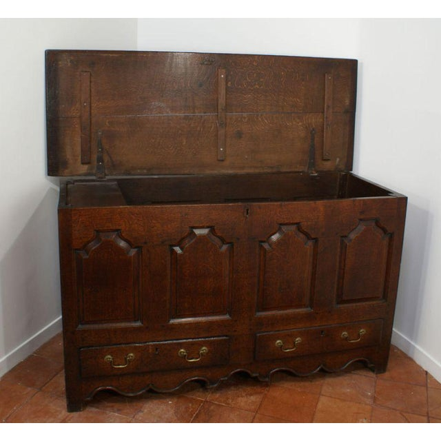 George II English oak paneled mule chest with scalloped apron. Great old finish. Nice color.