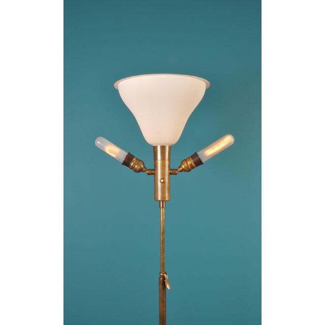Aged brass telescopic floor lamp from design, manufacturing firm BAG TURGI, Zurich Switzerland. New paraffin, leather...