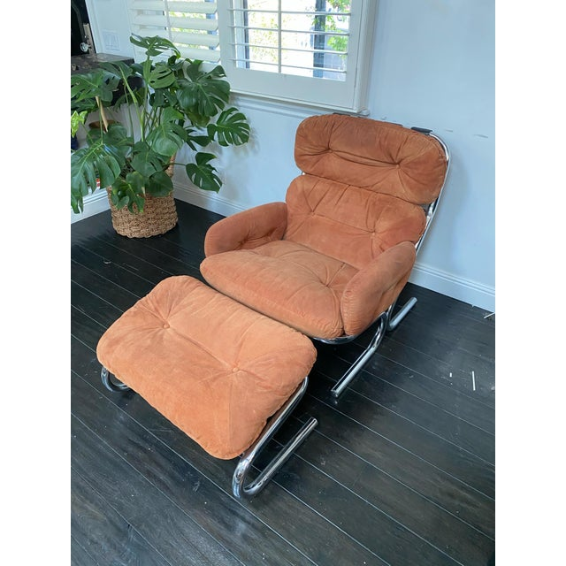 Mid-Century Modern tubular chrome and original orange suede lounge chair by Milo Baughman for Directional. This piece has...