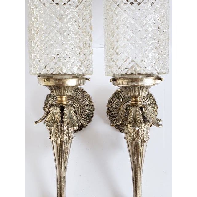 Very unique mid century Hollywood Regency style Spanish brass and glass sconces. This Spanish brass and the cross ribbed...