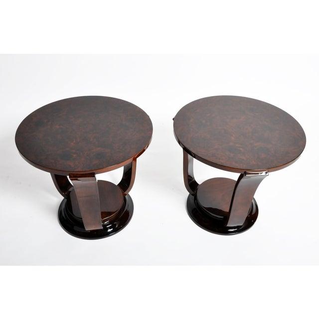 Handsome pair of contemporary round side tables from Hungary made from walnut veneer, circa 21st century. Price is for the...