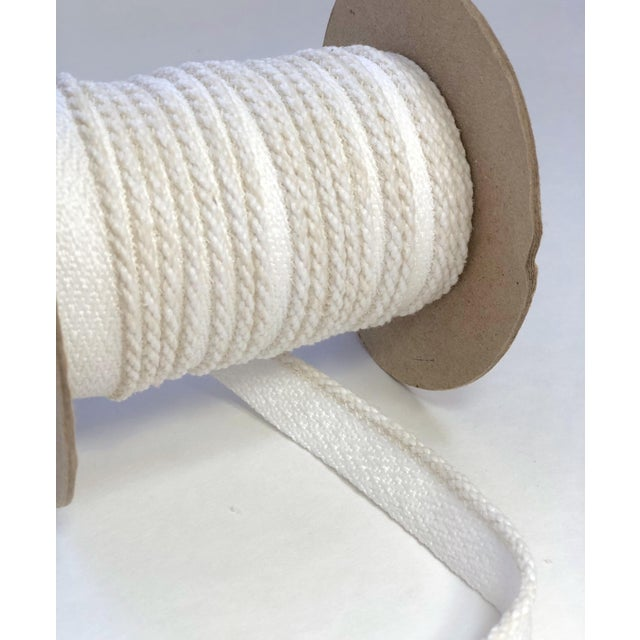 """One spool of 21 (yards) of braided cord with flange. Cord itself is 1/8"""" and comes w 1/2"""" wide flange for sewing. Cord..."""