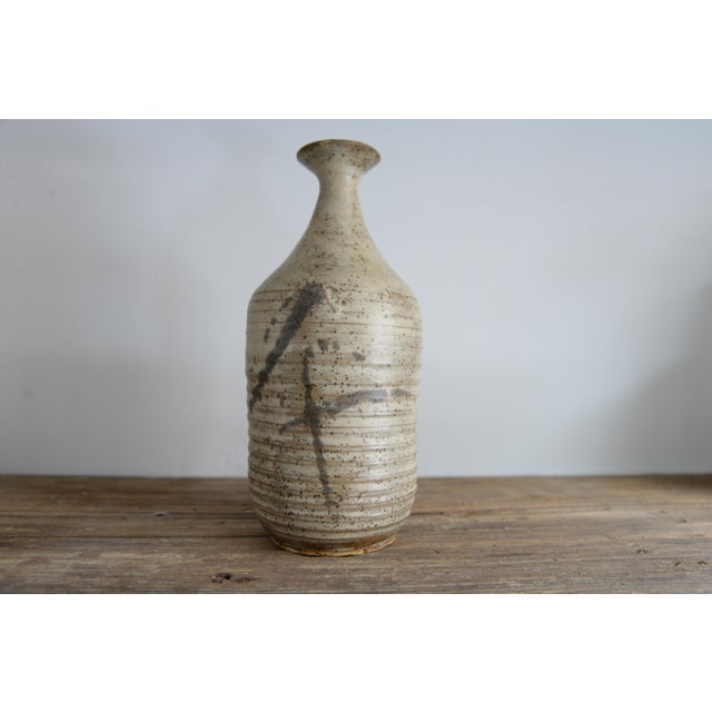 Incredible ceramic vessel with unique glaze very wabi sabi. In the style of Hans Cooper & Lucie Rie. Signed M Carr 64