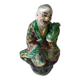 Chinese Republic Period Luohan Holding a Foo Dog Figure For Sale