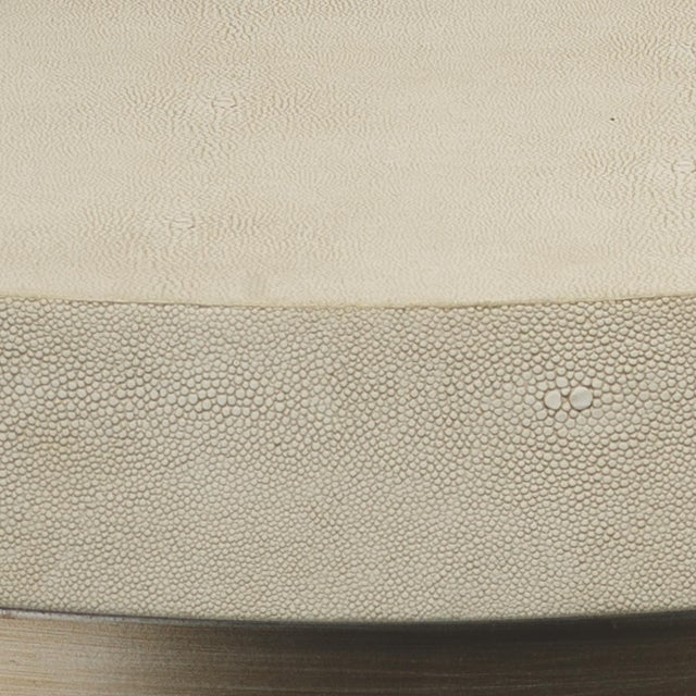 The exotic and modern texture of stingray skin or shagreen has been a favorite of designers since the 30's.The top and...