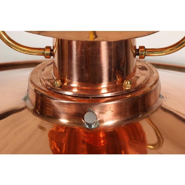 Single light copper disk with a lantern form top and a brass top suspension attachment. Condition: Very Good - A little...
