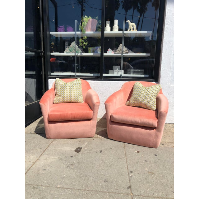 Vintage midcentury club chairs reupholstered in very soft velvet in a vibrant pink. Very comfortable as well! Can be sold...
