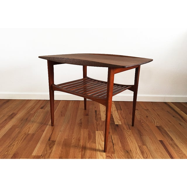 A Danish modern end table by Tove and Edvard Kindt-Larsen for John Stuart, made in Denmark in the 1960s. Solid teak with...