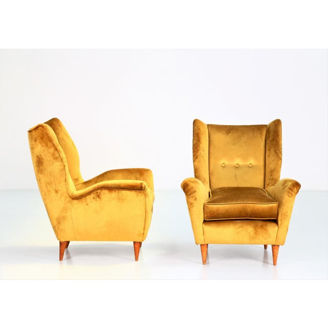 Pair of armchairs by gio ponti 1940 for isa bergamo. The armchairs have been restored in yellow velvet. Measurements:...