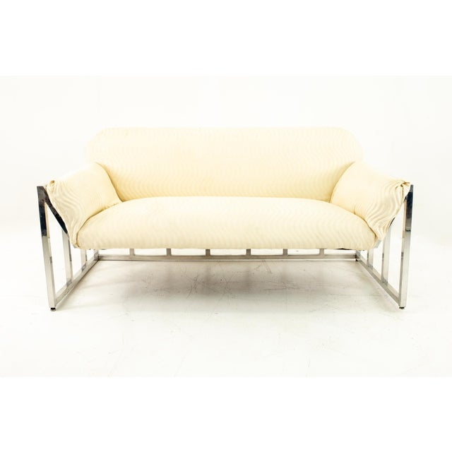 Milo Baughman Style Mid Century Floating Chrome Setee Setee measures: 59 wide x 31 deep x 29 high, with a seat height of...