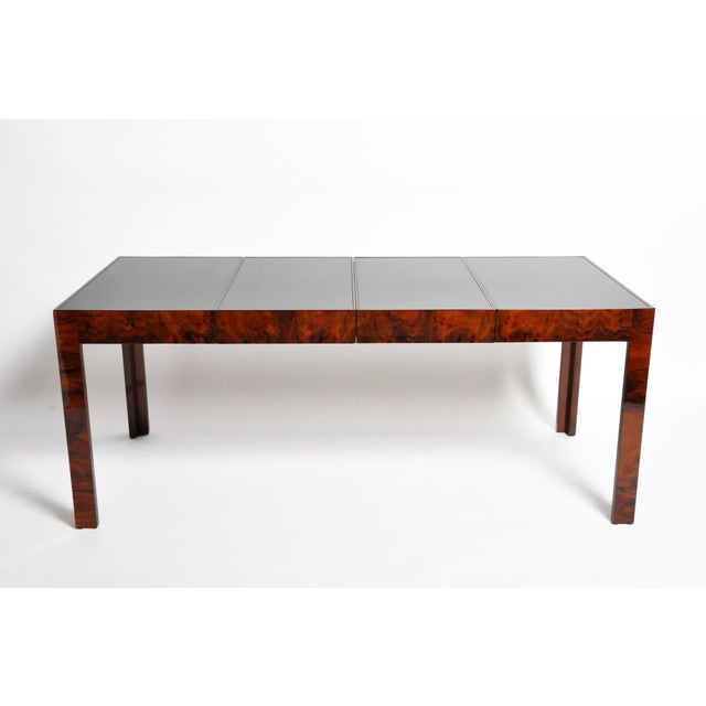 Elegant contemporary Hungarian dining table with extensions from Budapest, Hungary made from walnut veneer. Extensions in...