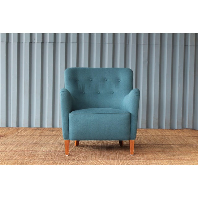 Early modern armchair designed by Ernest Race, England, 1940s. Recently upholstered in a beautiful dark teal fabric. His...