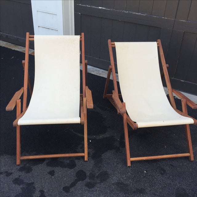 Wood slingback chairs covered in a cream/natural canvas. Fold flat for easy storage. Five different heights.Wood is a warm...