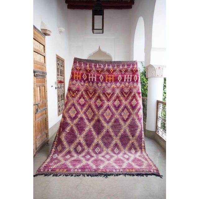 Beautiful bold Vintage Beni Mguild Moroccan Rug in perfect condition featuring colors in variegated purple, with details...
