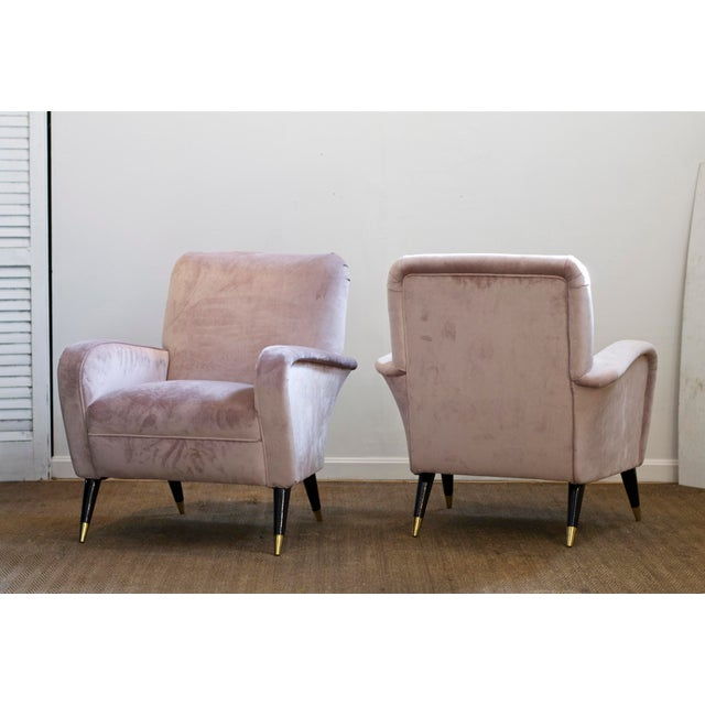 A supremely elegant pair of Italian Modern lounge chairs freshly dressed in a smoky and silky smooth lilac velvet. The...