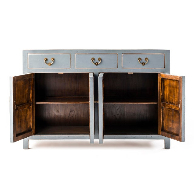An amazing and beautiful gray buffet table with lots of storage. Has 3 drawers and 4 doors, delicately made with our...