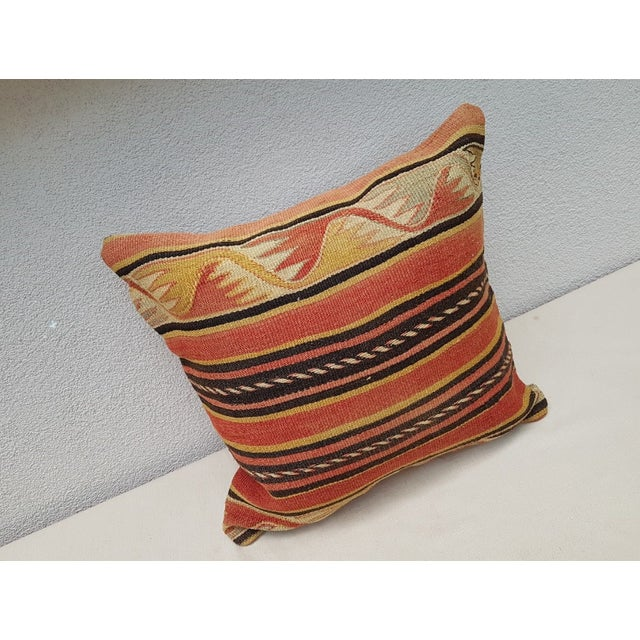 This handwoven kilim pillow is made from Anatolia and Middle-eastern kilim fragments. Each of our kilim pillow covers is...