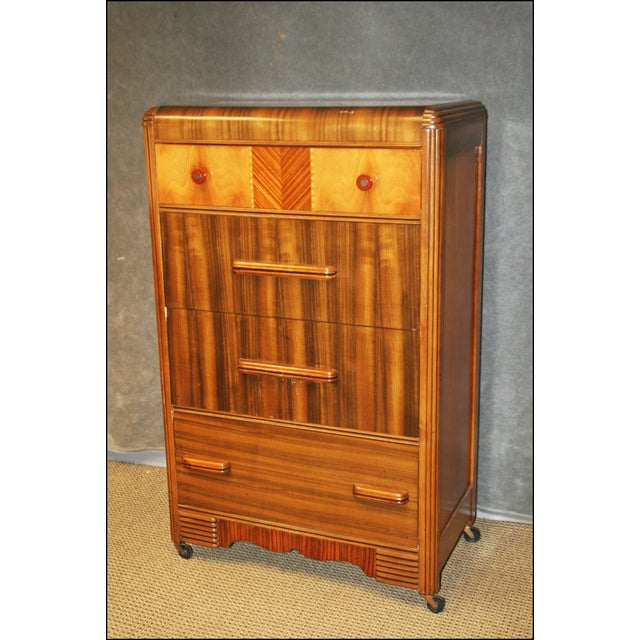 Tall dresser with four drawers. Art Deco style. Solid wood construction. Dovetail drawers. Top drawer has nice red...