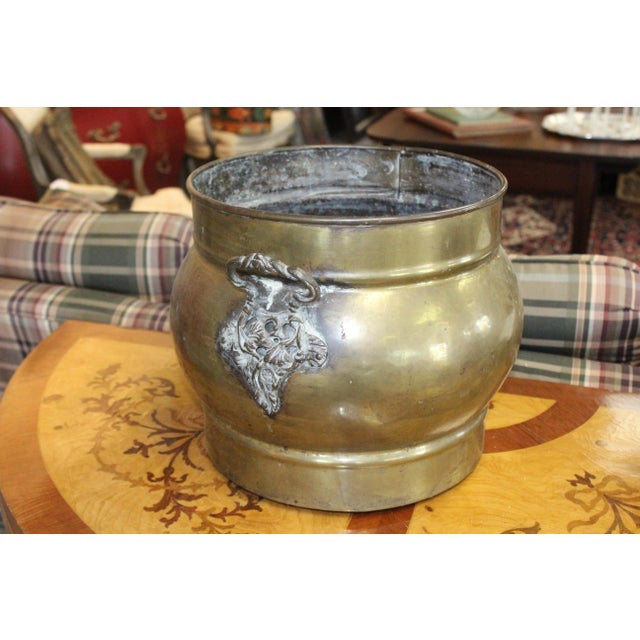 Hand made brass fireplace cachepot with double handles in floral design. Minor patina and spotting with age.