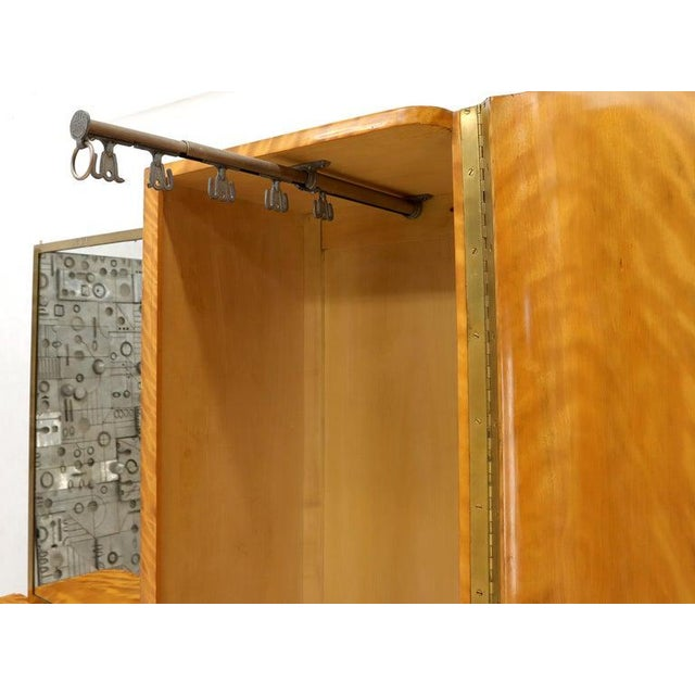 Fine Art Deco wardrobe vanity with brass frame mirror and hardware. Made in France.