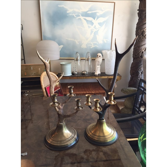 A beautiful pair of highly sought after Ralph Lauren Channing Stag 3 cup candlesticks. These have a beautiful mellowed...