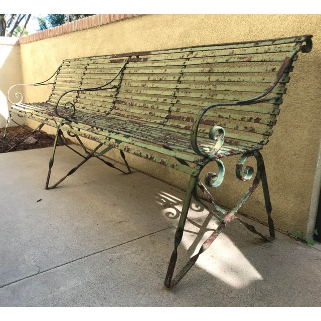 From Modcabana. This wonderful strap work wrought iron bench presents with a lovely patina. The original green paint is...