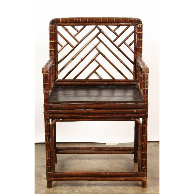 19th Century Chinese bamboo chair with a black seat.