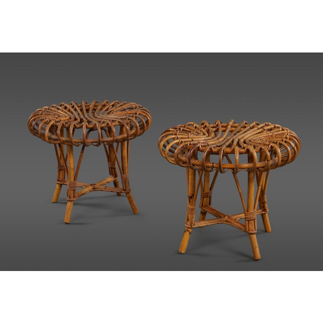 A petite pair of sculptural rattan stools.