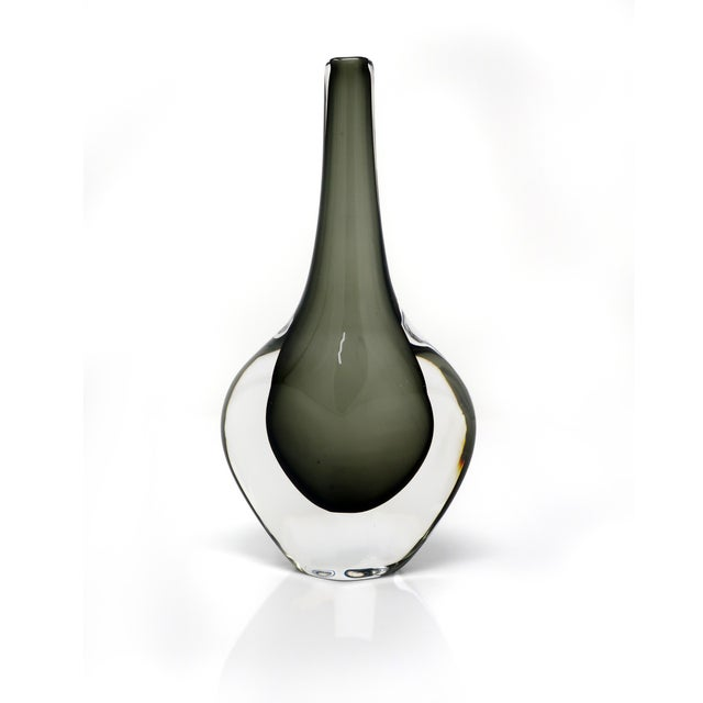 A sommerso glass vase designed by Nils Landberg for Orrefors. Showcases beautifully with a smokey green interior enveloped...