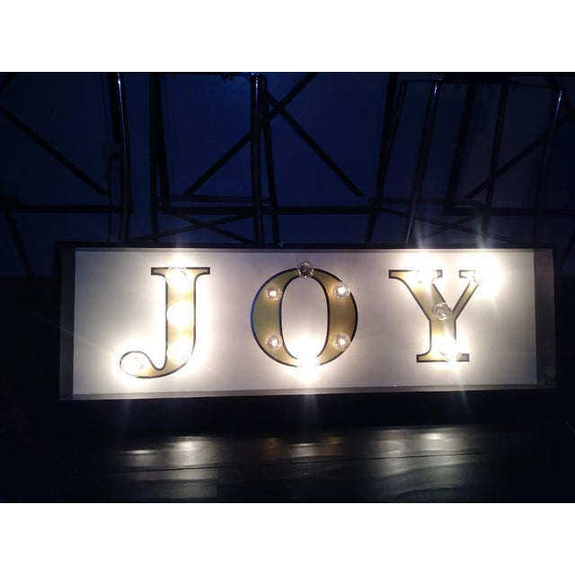 Large wall light up JOY sign. This piece you plug into the wall and it lights up beautifully and very bright Does not come...
