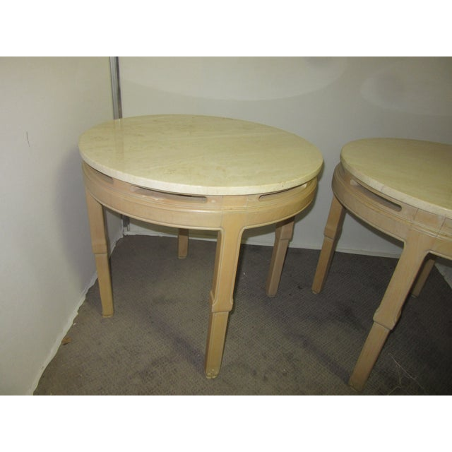 Pair of blonde wood round tables in the style of James Mont. The tables come with marble tops. There are Asian details...