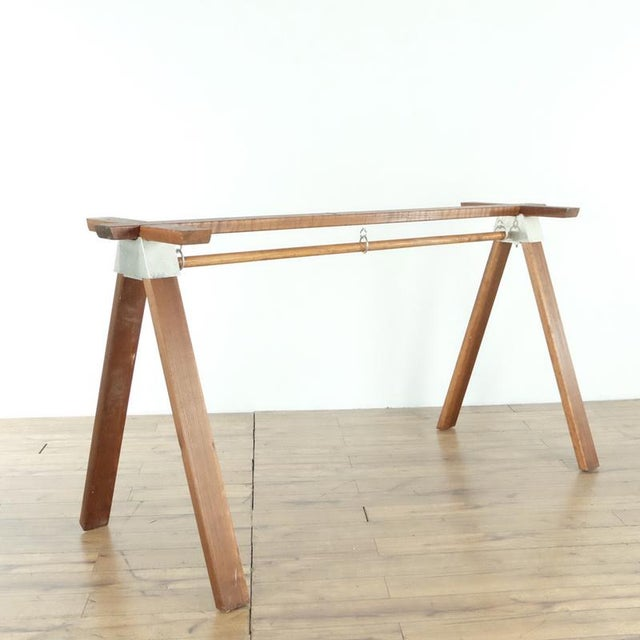 Bearing wood legs with a metal joinery system. A-frame structure. Made in Australia. Mid-century modern design. Lacking a...