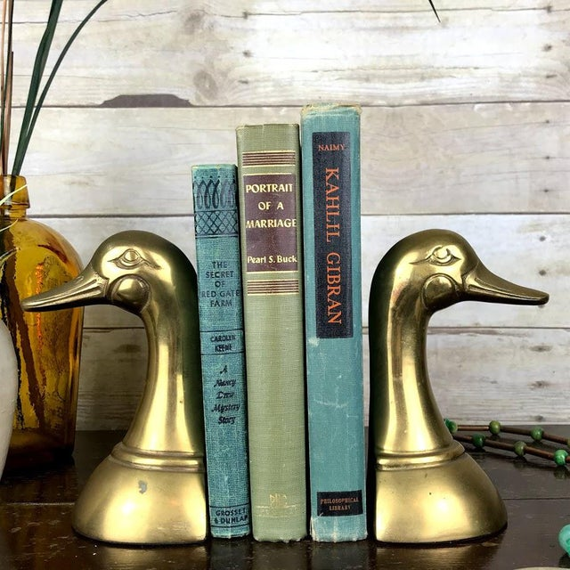 These gorgeous Mallard duck head bookends are a fun and sophisticated addition to your library or curio shelves. Featuring...