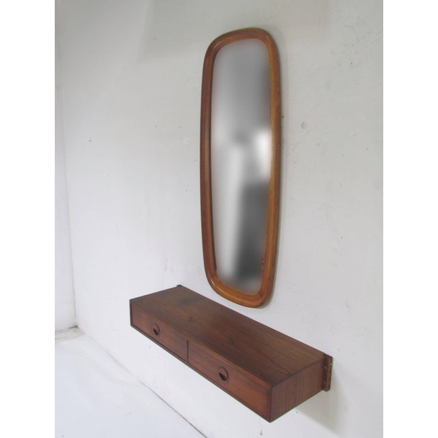 An elegant wall hanging shelf with two drawers by HG Mobler (Hansen / Guldborg) and teak framed mirror by Pedersen and...