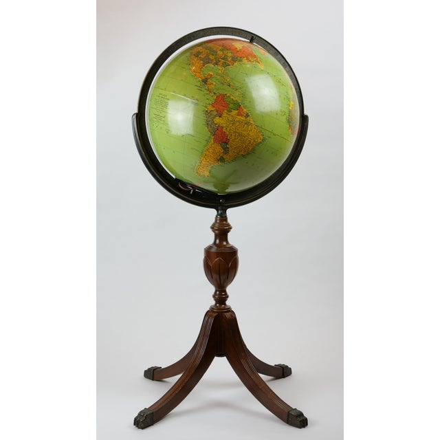 Mid-20th century wood and glass 16 inch standing library globe with interior light by Replongle Globes.