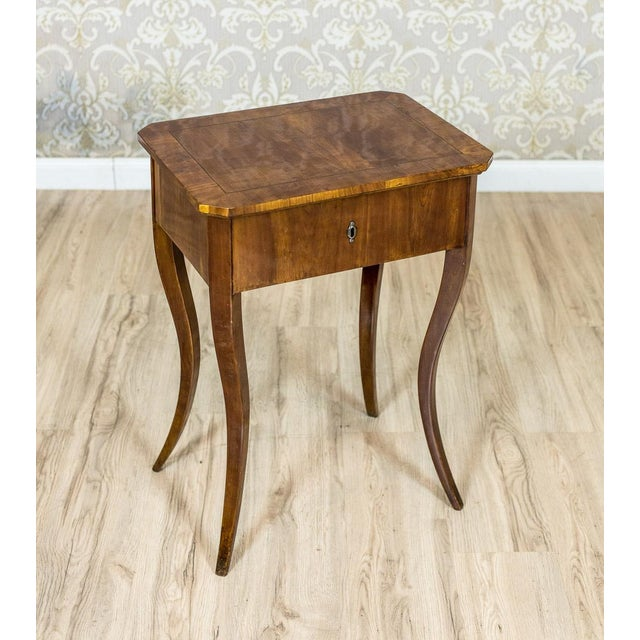 We present you this piece of furniture of a simple form veneered with cherry wood, characteristic for the early phase of...