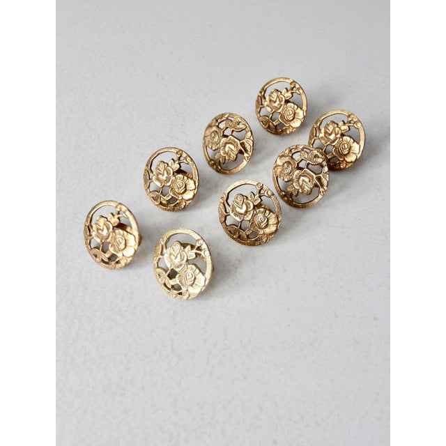 This is a set of 8 vintage brass napkin rings. Blossoming flowers set in a ring shape the stunning napkin holders. They...