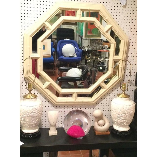 Faux bamboo Hollywood Regency octagonal mirror in crème or off-white. Heavy composition mirror that makes a real...