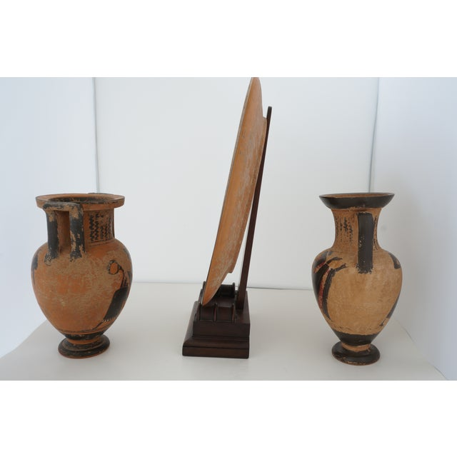 Vintage 1930s Ancient Greek Painted Terra Cotta Garniture - Charger Plate and Two Vases from a Palm Beach estate The...