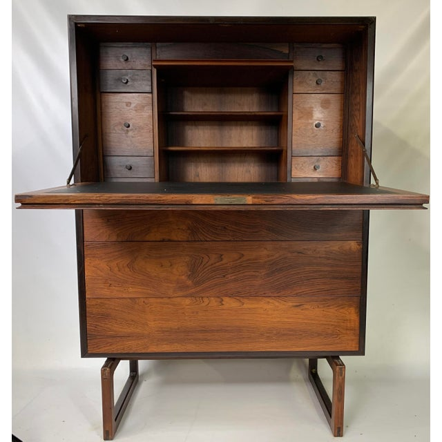 This bureau vanity desk contains a drop down top section that reveals a leather top for writing. The drawers to each side...